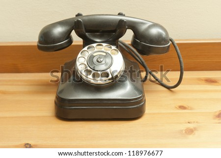 old fashioned classic rotary phone - stock photo