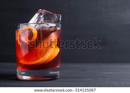 Old fashioned cocktail on the wooden background - stock photo