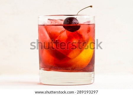 Old fashioned cocktail on white wooden background - stock photo