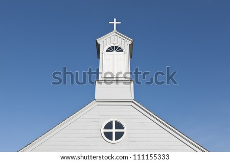 Old fashioned country church on a clear sunny day - stock photo