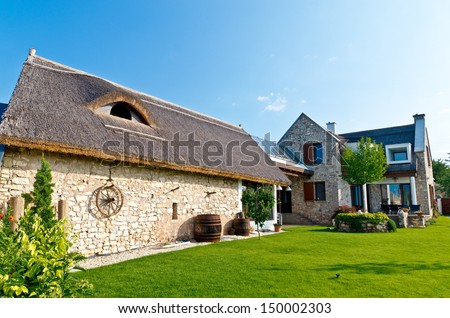 old fashioned country house with modern sun collectors - stock photo