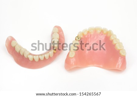 old fashioned dentures with gold facing - stock photo