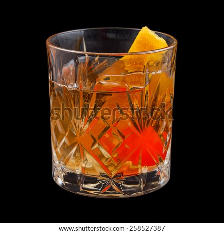 Old Fashioned drink, consisting of bourbon, sugar cube, angostura bitters and soda water. Isolated on black background - stock photo