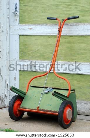 Old Fashioned Drop Seeder or Fertilizer Spreader - stock photo