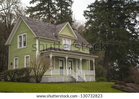 Old-fashioned farm house with a porch - stock photo
