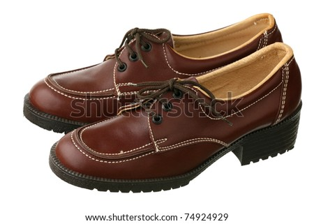 Old-fashioned female shoes on a white background - stock photo