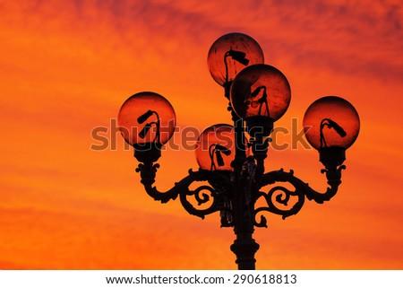 Old-fashioned lamp post in Mariinsky park in kiev - stock photo