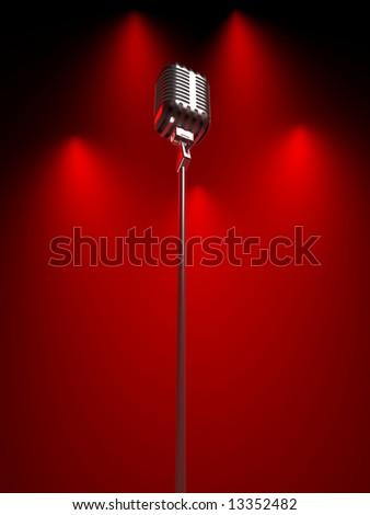 Old fashioned microphone under red spot lit background - stock photo