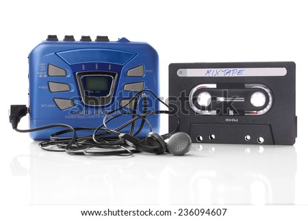 old-fashioned music cassette and walkman player with earphones - stock photo
