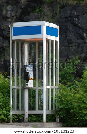 Old fashioned Phone booth with door. - stock photo