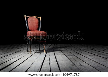 Old fashioned red chair on a wooden floor - stock photo