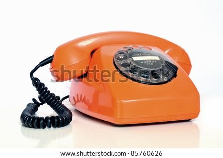 Old fashioned retro telephone orange on white background - stock photo