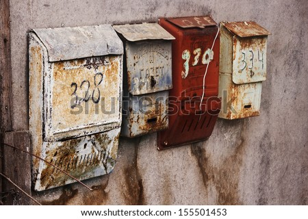 Old-fashioned russian mailboxes on the stucco wall - stock photo