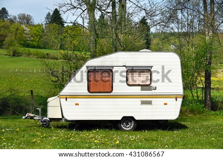 Old-fashioned 1980s caravan on a camping site in Belgium. - stock photo