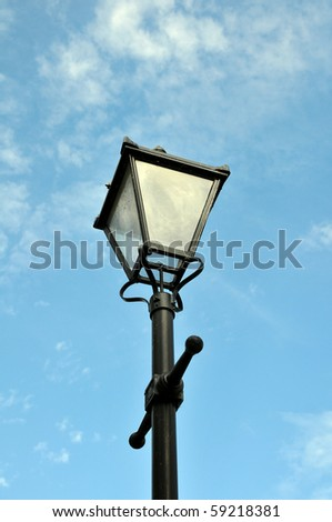 Old Fashioned Street Light against a Blue Sky - stock photo