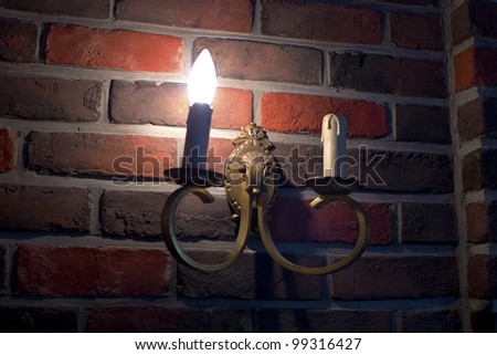Old fashioned street light on wall - stock photo
