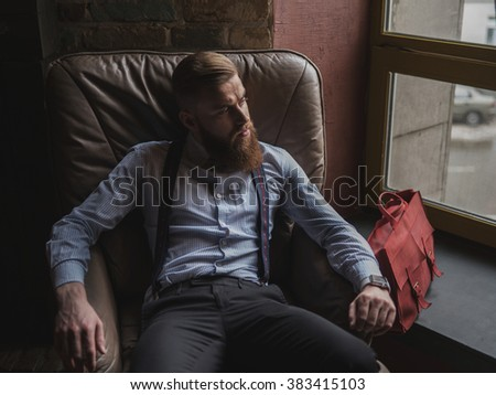 Old-fashioned successful businessman is relaxing at home - stock photo