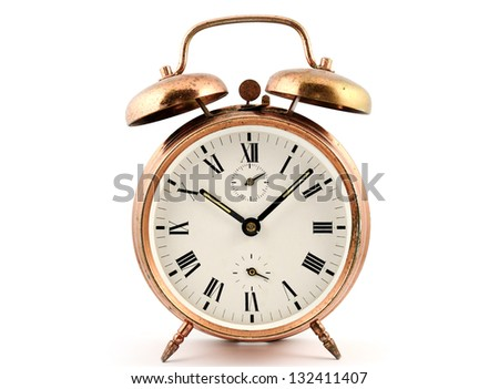 old-fashioned vintage copper alarm clock  against white - stock photo