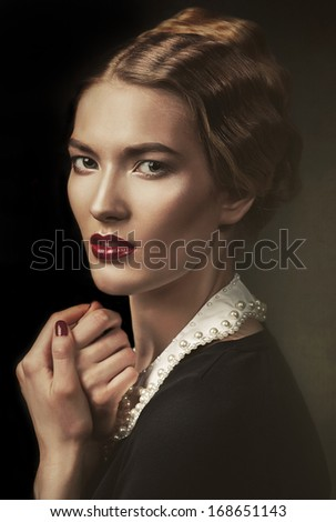 old-fashioned woman at window - stock photo