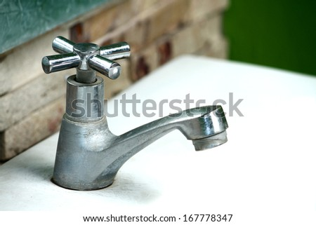 Old faucet - stock photo