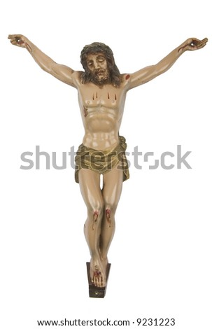 Old figurine of Jesus crucified, isolated on white - stock photo