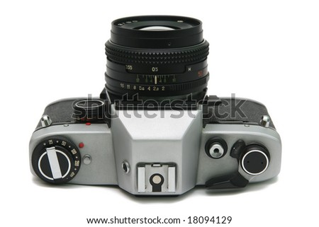 Old film camera on white background. - stock photo