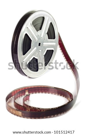 Old film reel with strip is isolated on a white background - stock photo