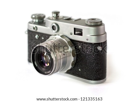 Old film SLR camera with lens macro shot isolated on white - stock photo