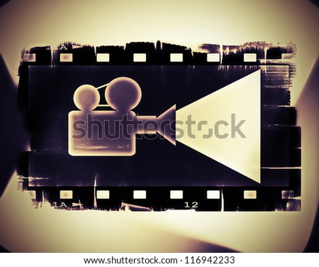 Old film strip frame and movie projector - stock photo
