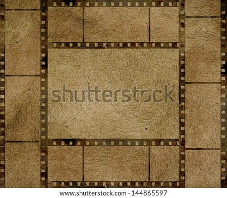 old film strip frame with some spots - stock photo