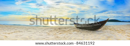 Old fisherman boat at the beach. Panorama - stock photo