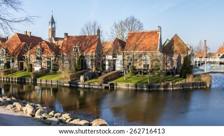 Old fisherman's houses in Enkhuizen Netherlands as part of the Zuiderzeemuseum - stock photo