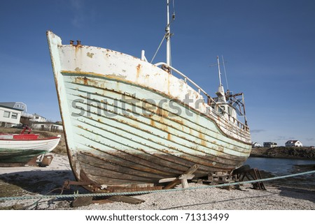 Old Fishing-boat at Seashore in Iceland - stock photo