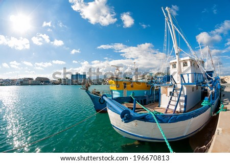 Old fishing boat in Limassol harbour. Cyprus - stock photo