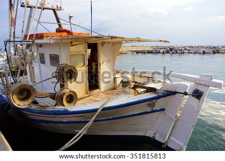 Old fishing boat in the port. Fishing tools.Mediterranean sea. Greece - stock photo