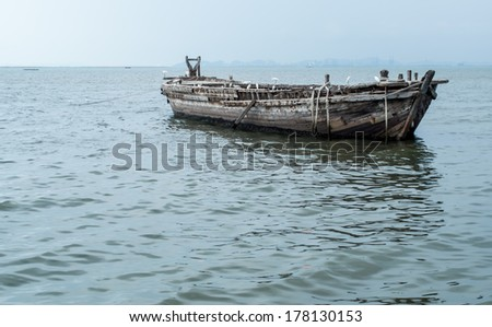 Old fishing boat with Sanctuary Birds over sea - stock photo