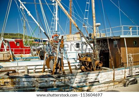 Old fishing boats fleet in Kukljica harbor, Island of Ugljan, Croatia - stock photo