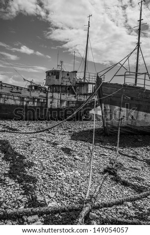 old fishing boats - wrecks - stock photo