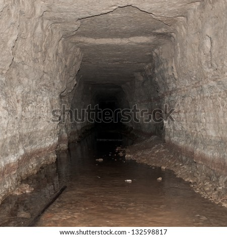 Old flooded limestone tunnel. Peter the Great's Naval Fortress. - stock photo
