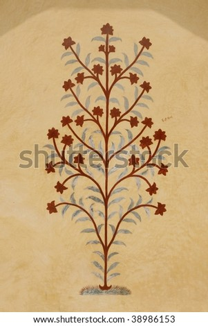 Old flower painting on the Amber Fort temple wall, Rajasthan, India - stock photo