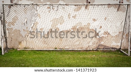 old football gates stand near the wall - stock photo