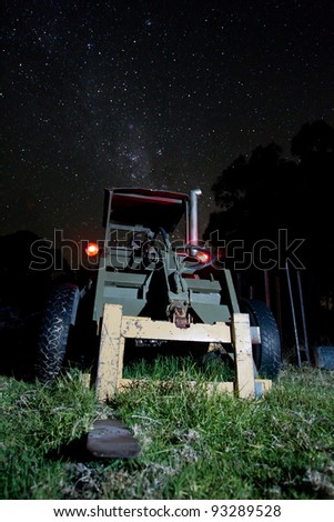 Old Forklift, with the milkyway in the background. - stock photo