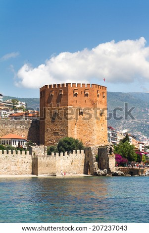 Old fortress, Red Tower, Kizil Kule in Mediterranean Sea, Alanya, Antalya, Turkey - stock photo