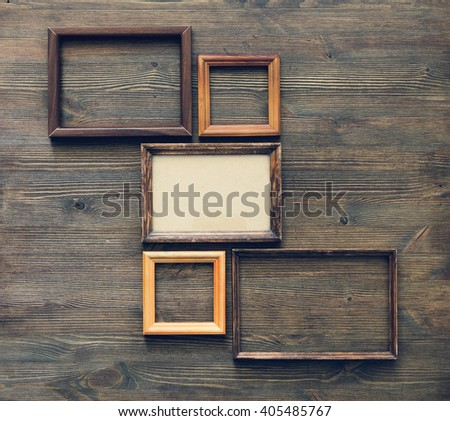 old frames on wooden wall - stock photo