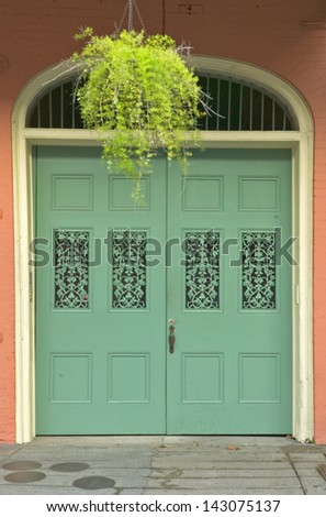 Old freshly painted doors in French Quarter near Bourbon Street in New Orleans, Louisiana - stock photo