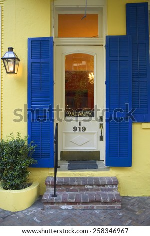 Old freshly painted doors of hotel in French Quarter near Bourbon Street in New Orleans, Louisiana - stock photo
