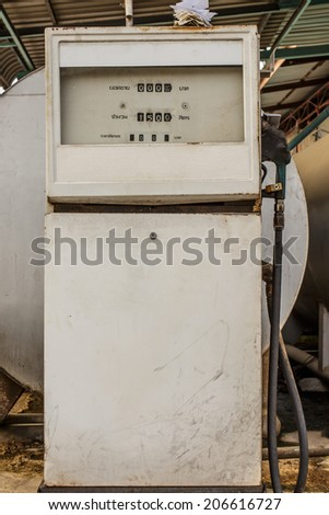 old fuel pump with fuel tank - stock photo