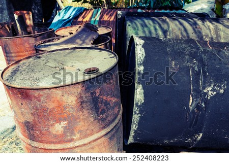 old fuel tanks that lay altogether - stock photo