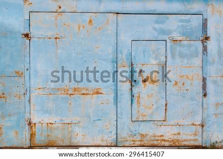 old garage door with traces of rust - stock photo