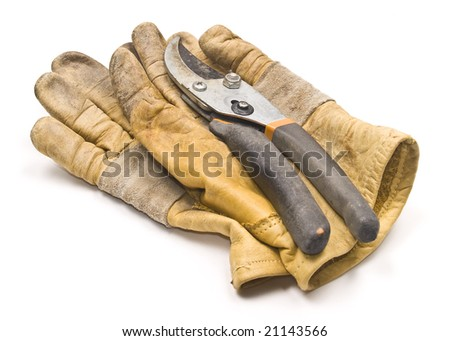 Old gardening gloves with pruners - stock photo